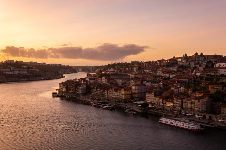 View from D. Luis bridge to the city of Porto and to the Douro river at sunset.