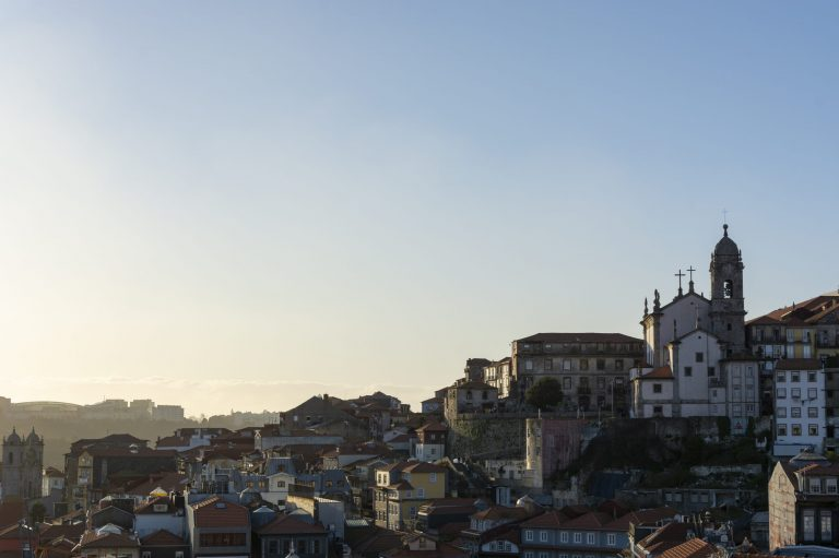 View to the historical part of the city of Porto (Portugal). Sunset and sky with clouds.